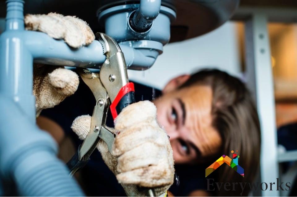 plumber-handyman-fixing-a-leaking-pipe-everyworks-handyman-singapore_wm