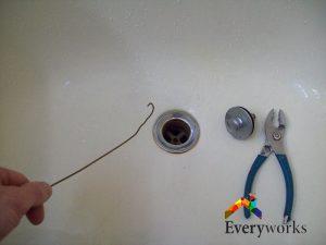 wire-hanger-toilet-bowl-choke-everyworks-plumber-singapore