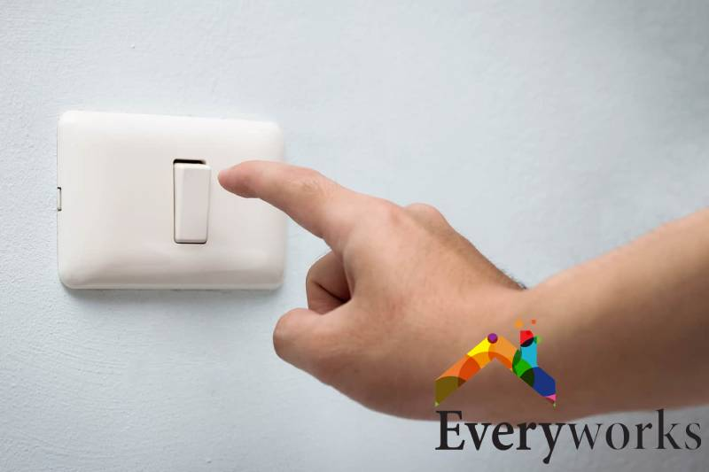 hand-near-switch-light-switch-repair-everyworks-electrician-singapore