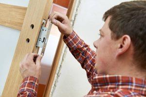man-taking-measurements-door-lock-services-everyworks-handyman-singapore