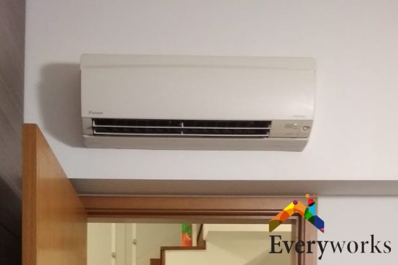 aircon-installed-above-doorway-noisy-aircon-everyworks-aircon-servicing-singapore